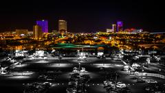 streets and distant casinos at night in atlantic city, new jersey. - stock photo