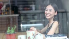 Beautiful asian woman drinking coffee Stock Footage
