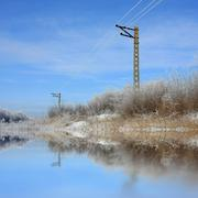 Electrical line in the steppe near lake Stock Photos