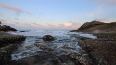 Evening scene of sea wave and stone reef Stock Footage