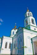 cathedral with cupola on blue sky background - stock photo