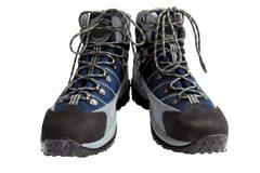 Pair of hiking boots isolated on white background - stock photo