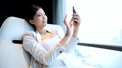 Female Asian Chinese Relaxing The Bund Penthouse Shanghai Smart Phone - stock footage