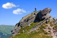 Stock Photo of Man stay on mountain top