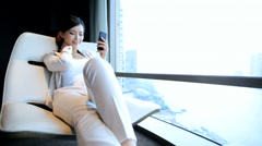 Female American Ethnic Relaxing The Bund Penthouse Shanghai Smart Phone - stock footage