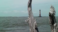 Drift wood ocean light house Stock Footage
