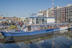 canal cruise in amsterdam - stock photo