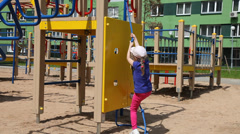 Active little girl playing on a training equipment Stock Footage