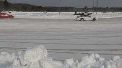 Cars racing on ice track in Minden Ontario Canada Stock Footage