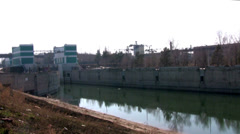 Dam on the canal in the spring in Siberia Stock Footage