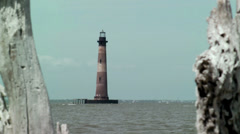 Drift wood and light house Stock Footage