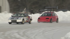 Cars racing on ice race track on cold winter day Stock Footage
