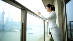 Wireless Smart Phone Female Asian Chinese Hotel Penthouse Shanghai - stock footage