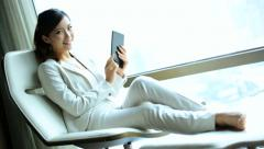 Portrait Female Asian Chinese Traveller Penthouse Shanghai Recliner Tablet - stock footage