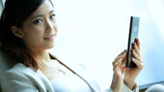 Female Portrait Asian Chinese Traveller Penthouse Shanghai Recliner Tablet - stock footage