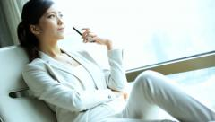 Female American Asian Chinese Relaxing The Bund Penthouse Shanghai Smart Phone - stock footage