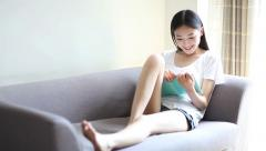 young woman reading a book on the couch - stock footage