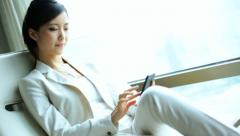 Female Asian Chinese Business Traveller Penthouse Shanghai Recliner Smart Phone - stock footage
