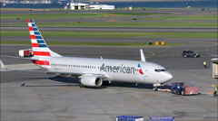 American Airlines plane towed to gate Stock Footage