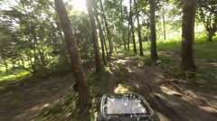 Mountain Biking in Rubber Tree Plantation Stock Footage