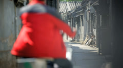 Moped rider buildings Chinese street China East Asia - stock footage