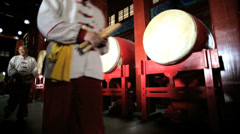 Chinese drum players leaving Drum Tower Beijing China Stock Footage