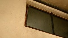 View from below on the boarded up window in the cellar Stock Footage