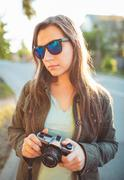 Lifestyle portrait of pretty young fashion brunette in sun glasses on the sun Kuvituskuvat