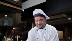 Stock Video Footage of Charming cook making dessert in kitchen, culinary show host, click for HD