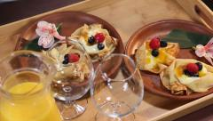 Mouth-watering dessert pancakes served for two persons on a tray, click for HD Stock Footage