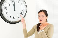 Timing - Surprised face businesswoman casual - stock photo