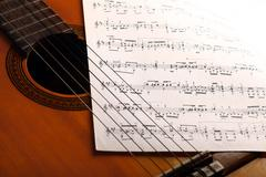 Classical guitar and notes Kuvituskuvat