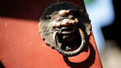 Chinese brass knocker symbol of the past Imperial Lion Beijing China Stock Footage