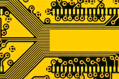 Yellow circuit board with space for text - stock photo