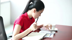 Young businesswoman in her office Stock Footage