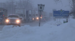 Severe blizzard stops truck traffic in winter storm Stock Footage