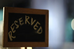 Reserved sign on a restaurant table, empty champagne glasses, click for HD Stock Footage