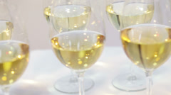 Several glasses with white wine Stock Footage
