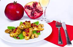Breaded chicken's breast with pomegranate Stock Photos