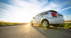 Car on road over sunny day Stock Photos