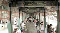 Summer Palace Long Corridor tourist destination Beijing China Stock Footage