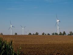 Wind turbines on farmland Stock Photos