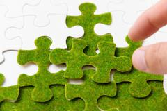 green puzzle piece, green space concept - stock photo