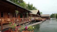 Bungalows on the Kwai river near Bangkok in northwestern Thailand. Stock Footage