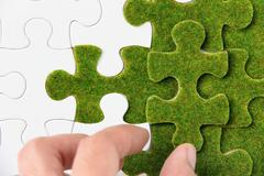 green puzzle piece, green concept - stock photo
