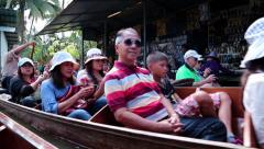 People in boats at the floating market near Bangkok in Thailand Stock Footage
