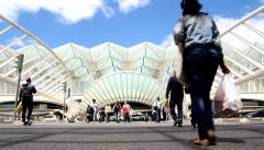People crossing in front of Oriente Station in Lisbon Portugal. Stock Footage