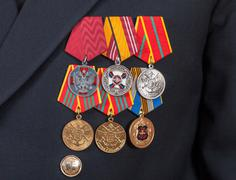 different awards and medals on the russian navy uniform - stock photo
