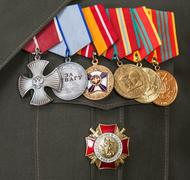 different awards and medals on the russian army uniform - stock photo