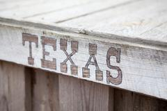 Stock Photo of texas lettering on wooden plate, inscription